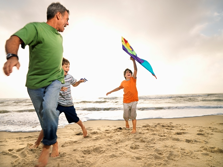 Kids and Dad Playing with Kite